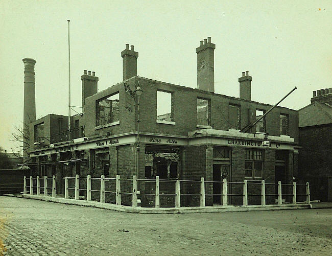 Old Bargehouse, viewed from Bargehouse Road, 1940, author unknown [https://pubshistory.com/EssexPubs/NorthWoolwich/barge.shtml].